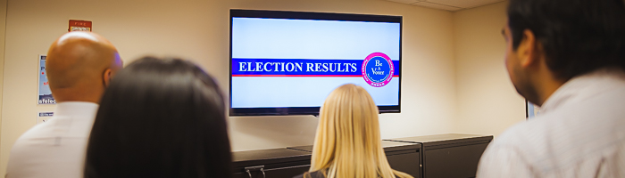 People viewing election results on a TV