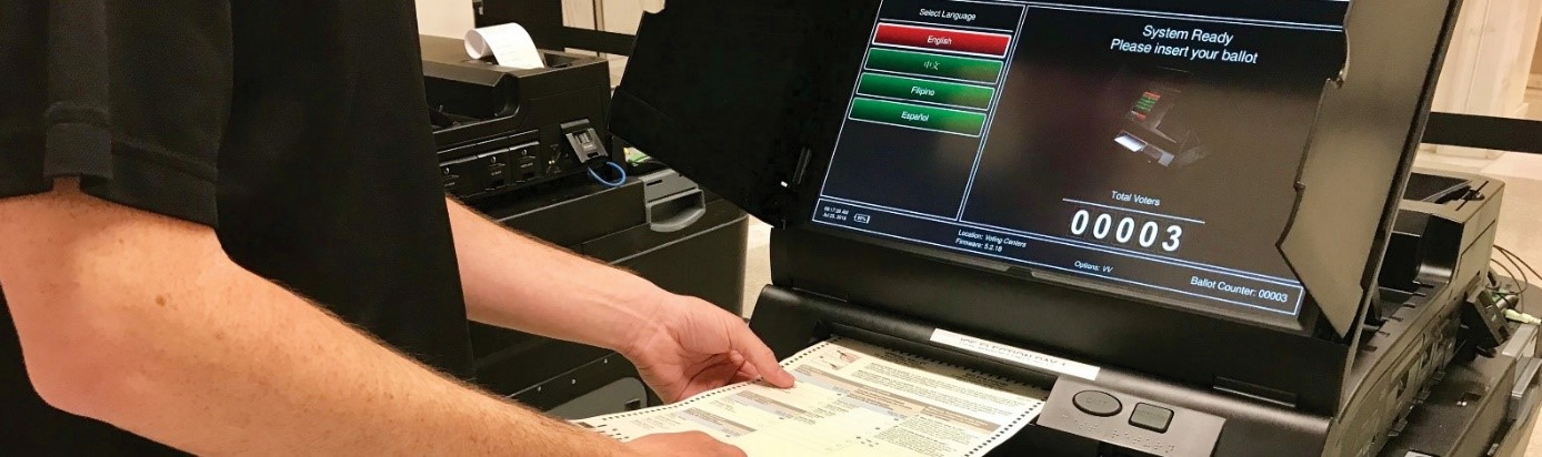 Ballot being fed into ICX voting machine