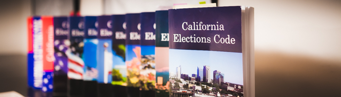 California Elections Code books from different years displayed in a line