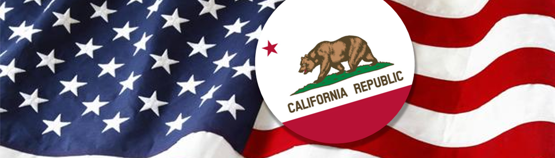 """A button of the California flag is placed on top of an American flag"